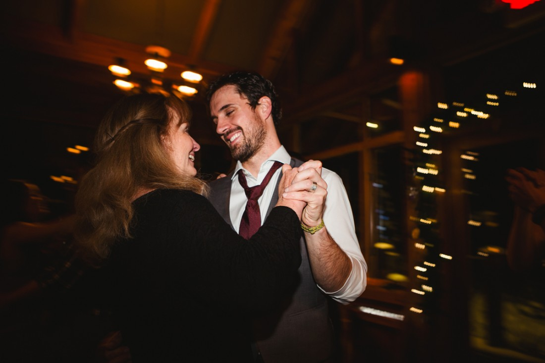 Groom dancing with his mom in the reception hall in edgewater lodge, Whistler