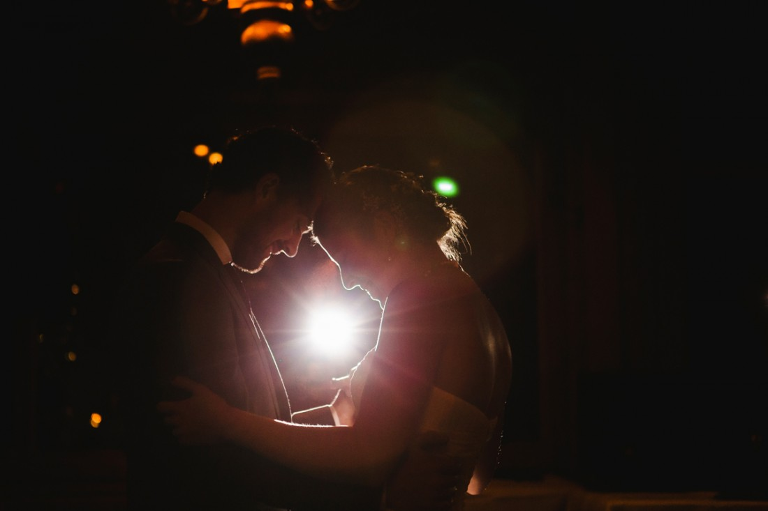 back lit first dance of bride and groom in the reception hall of edgewater lodge, Whistler
