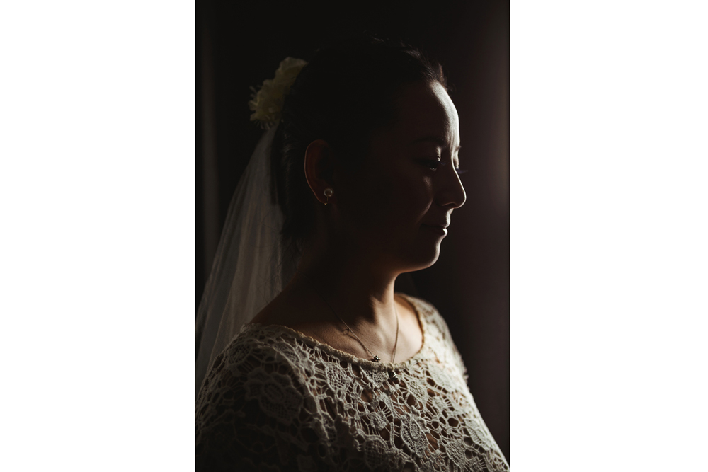 silouette of the bride in front of the curtain, before heading towards her reception hall vieux port steakhouse for her winter intimate wedding