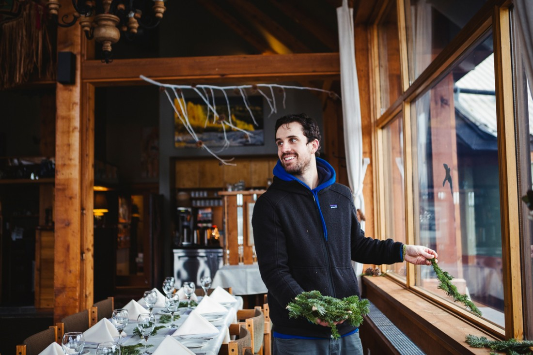 groom helping to decorate the reception hall with the pine nuts she collected during the summer in vancouver stanley park
