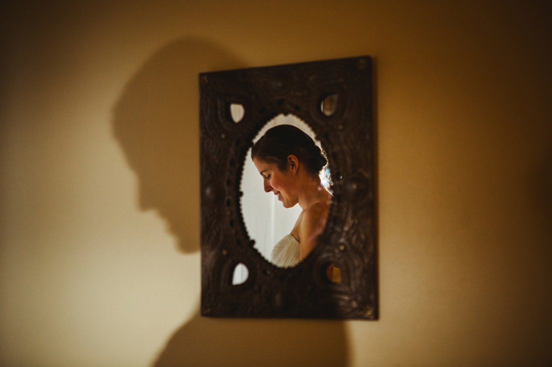 bride in the mirror in contrast against her own shadow