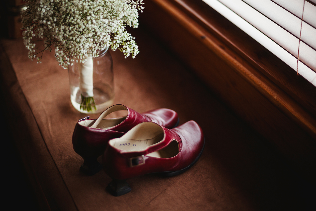 vintage john fluevog red leather wedding shoes and hand made wedding bouquet