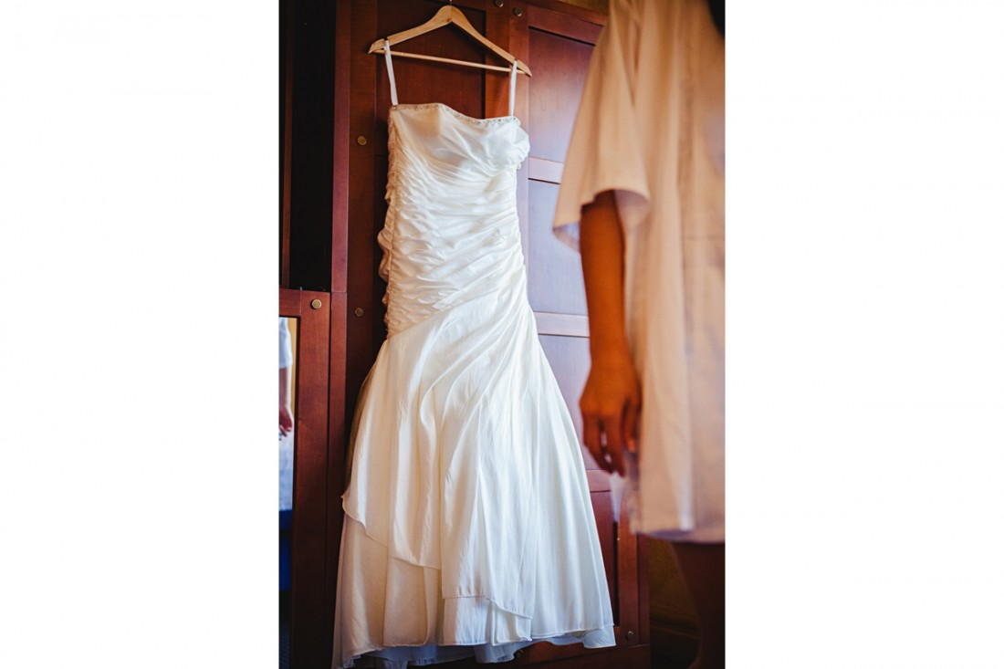 Wedding dress hanging in the luxor hotel roomto get ready for Amy and Ken's destination wedding