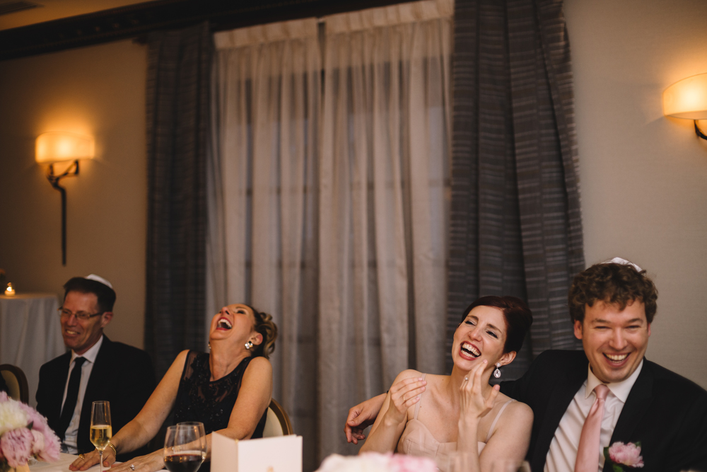 Bride and groom having fun with guests in their reception hall in Ritz-Carlton Montreal.