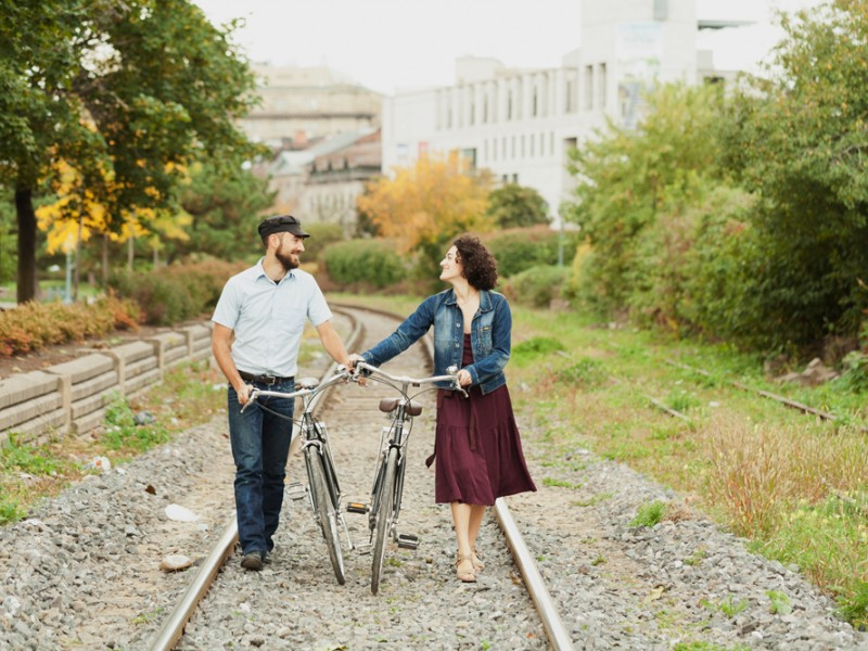 Couple walking in railway with vintage bikes