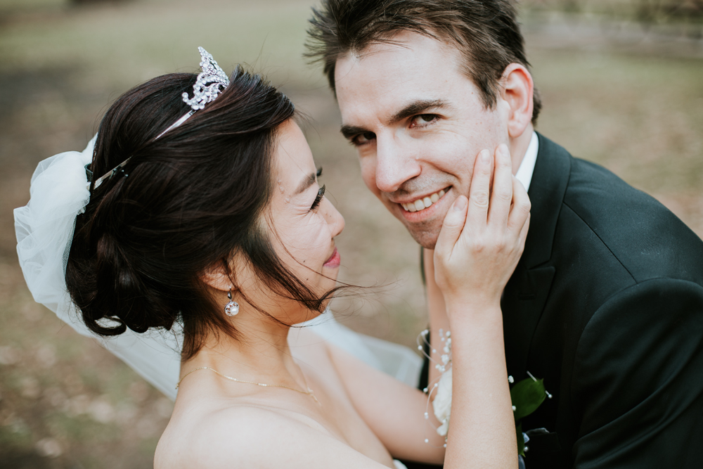 Korean Bride and Romanian groom having intimate moment after ceremony