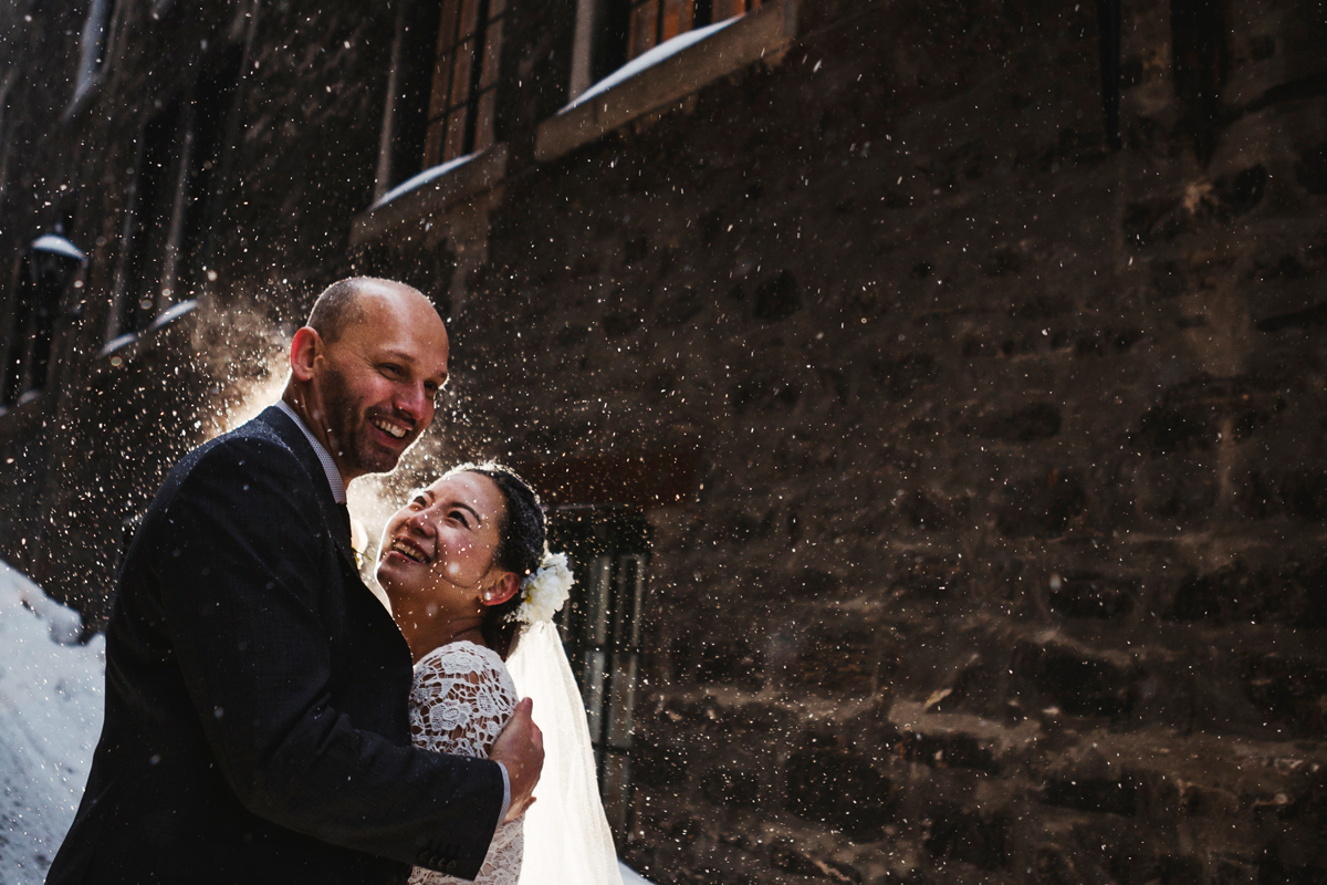 newlyweds brave the cold in the snow storm in old port Montreal