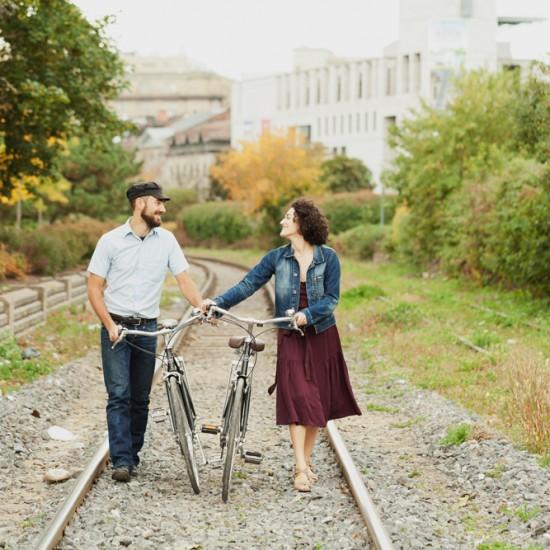Couple walking in railway with vintage bikes
