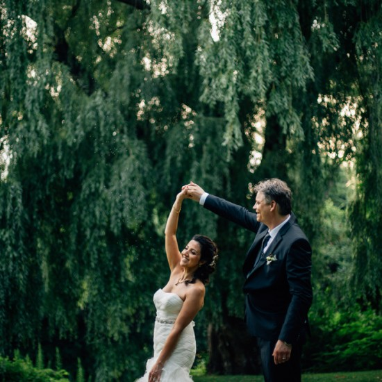 Bride and groom dancing in the nature for their summer wedding in pavillion de_la jamaïque Montreal