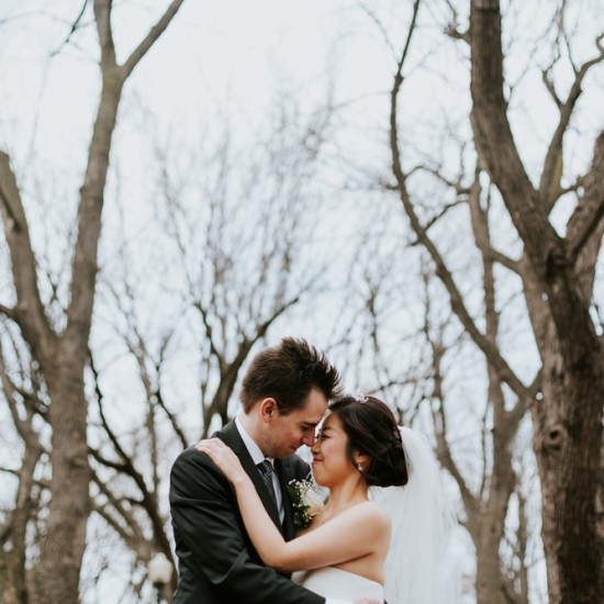 Korean Bride and Romanian groom having intimate moment in the wood